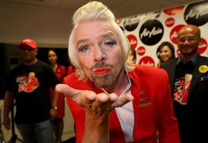 Richard Branson Dolls Up As AirAsia Stewardess After Losing Bet